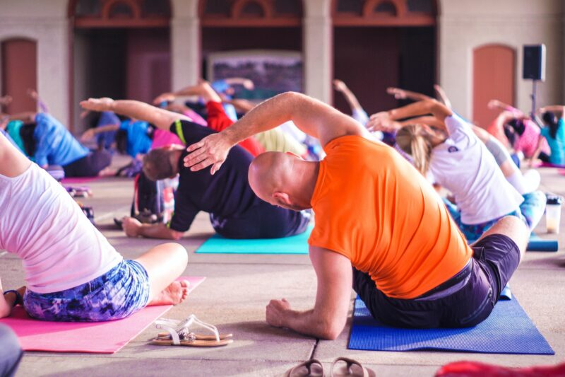 employees participating in a wellness yoga class