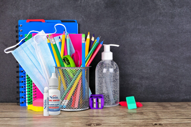 school supplies and infection prevention supplies on a desk